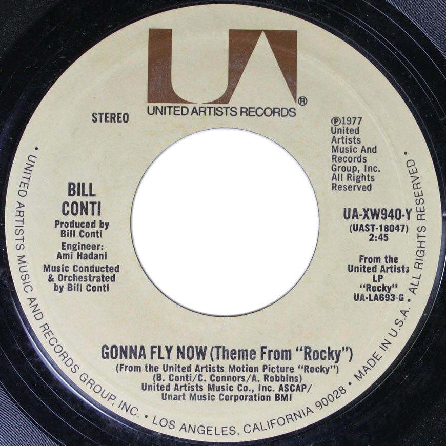 "Bill Conti -- ""Gonna Fly Now (Theme From Rocky) / Reflections"" (single, A-side label)"